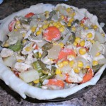 fill the pie pan with the chicken and vegetable mixture