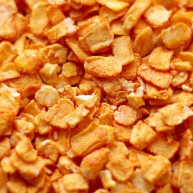 Peach Flavored Dehydrated Apple Flakes in a case